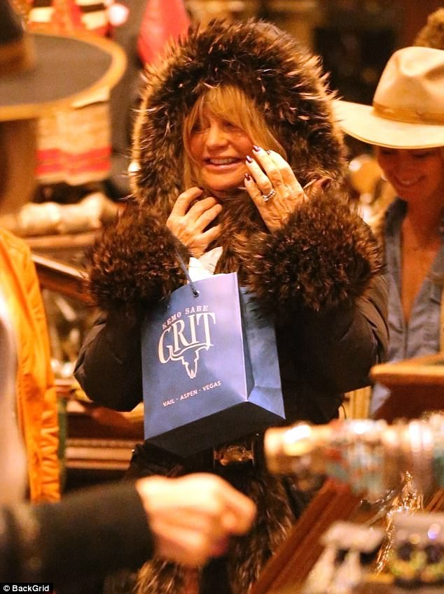 Shopping trip: Goldie Hawn flashed her adorable smile on Thursday while shopping with longtime partner Kurt Russell in Aspen