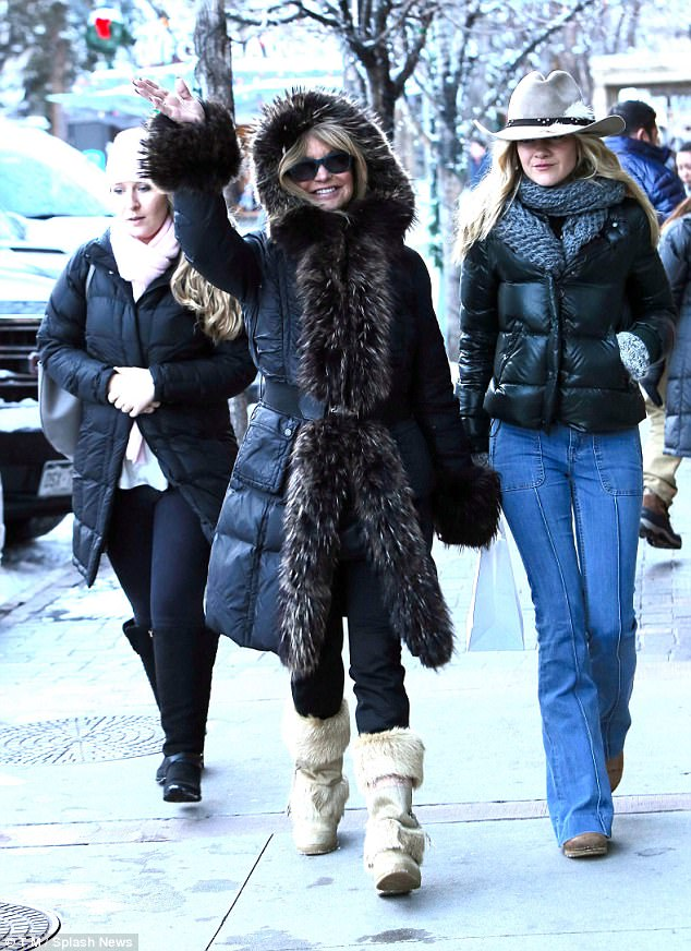 Warm this winter: Actress Goldie Hawn, 72, got into the festive spirit in a fur-lined as she enjoyed a spot of retail therapy in Aspen on Friday