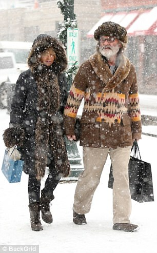 Snowy sidewalk: The Hollywood stars bundled up as they walked outside in the snow