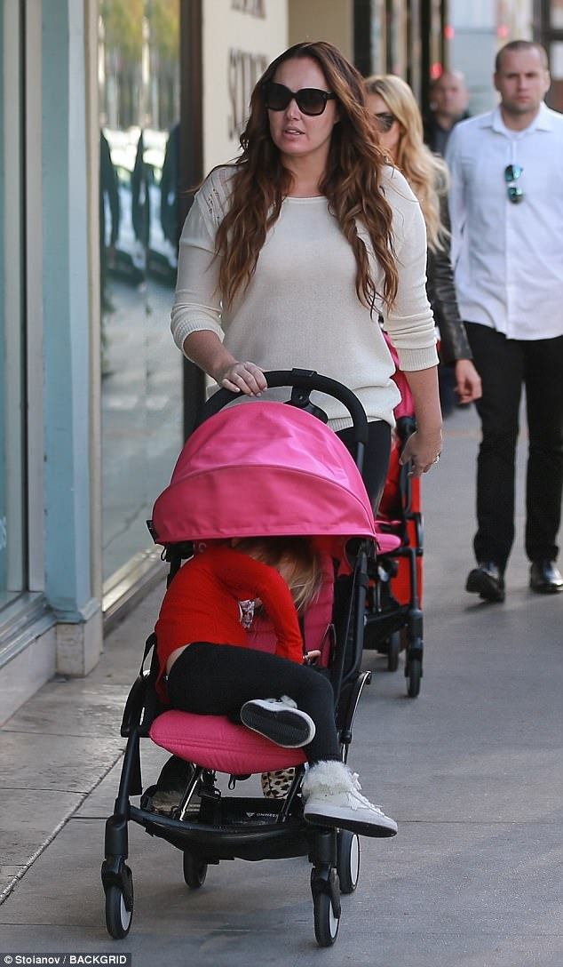 Cute:The billionaire F1 heiress brought along her three-year-old daughters Sophia, three, for the search for last-minute festive gifts
