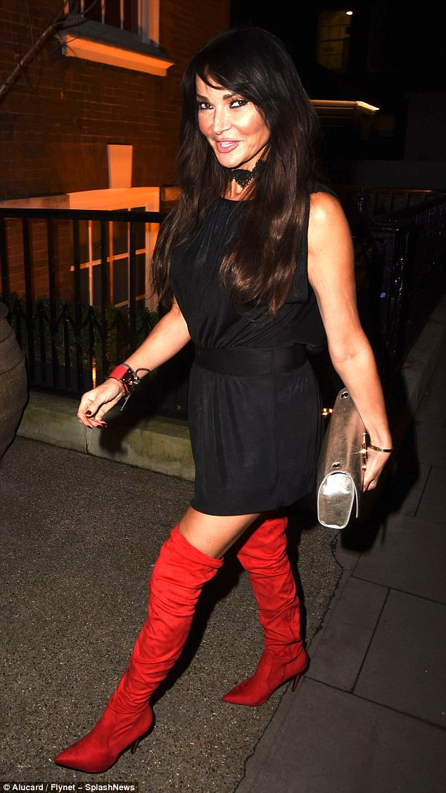Toned: The age-defying presenter looked full of festive fun as she strode along to the party