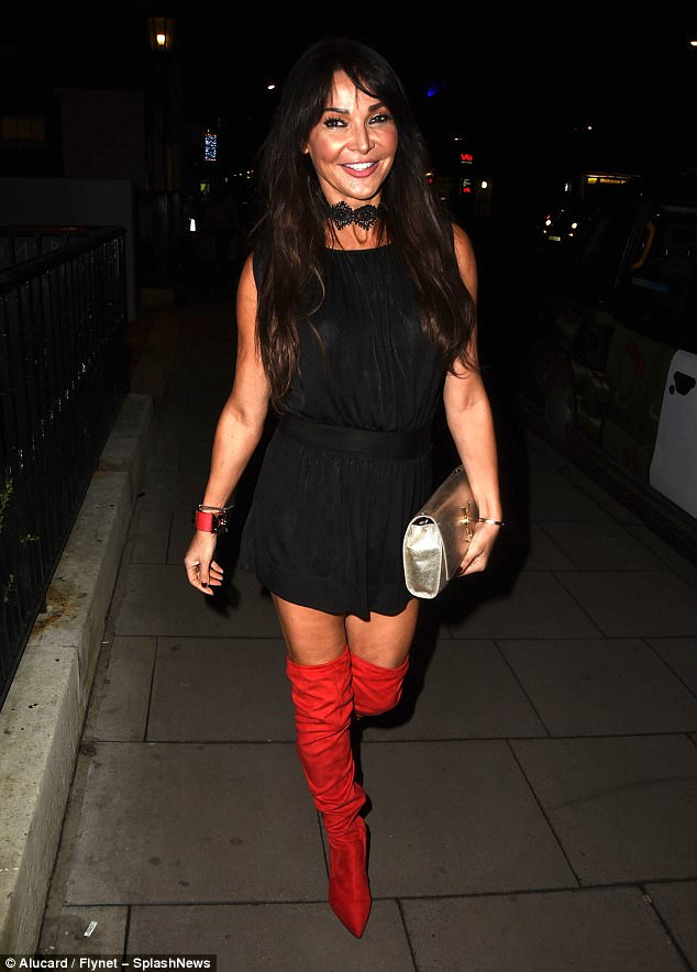 Glamourpuss: She was joined by celebrity pals for the occasion with Lizzie Cundy, 47, showing off her toned figure in a chic black LBD paired with racy red thigh-high boots