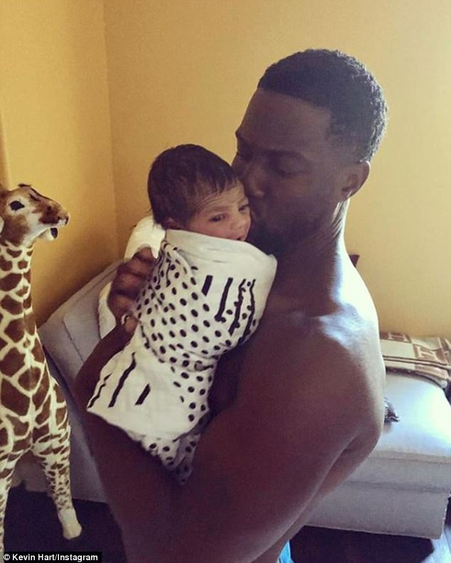 Newest addition: This comes just a month after Kevin , seen with newborn Kenzo, said he has never changed a diaper, despite being a father to three children