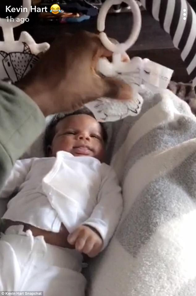 Cosy: Proud dad Kevin shared this video of his son wrapped in a blanket while looking at a mobile