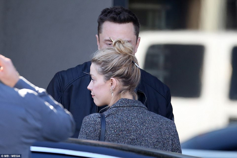 Natural beauty: Amber added delicate earrings with her blonde locks pulled up into a high bun
