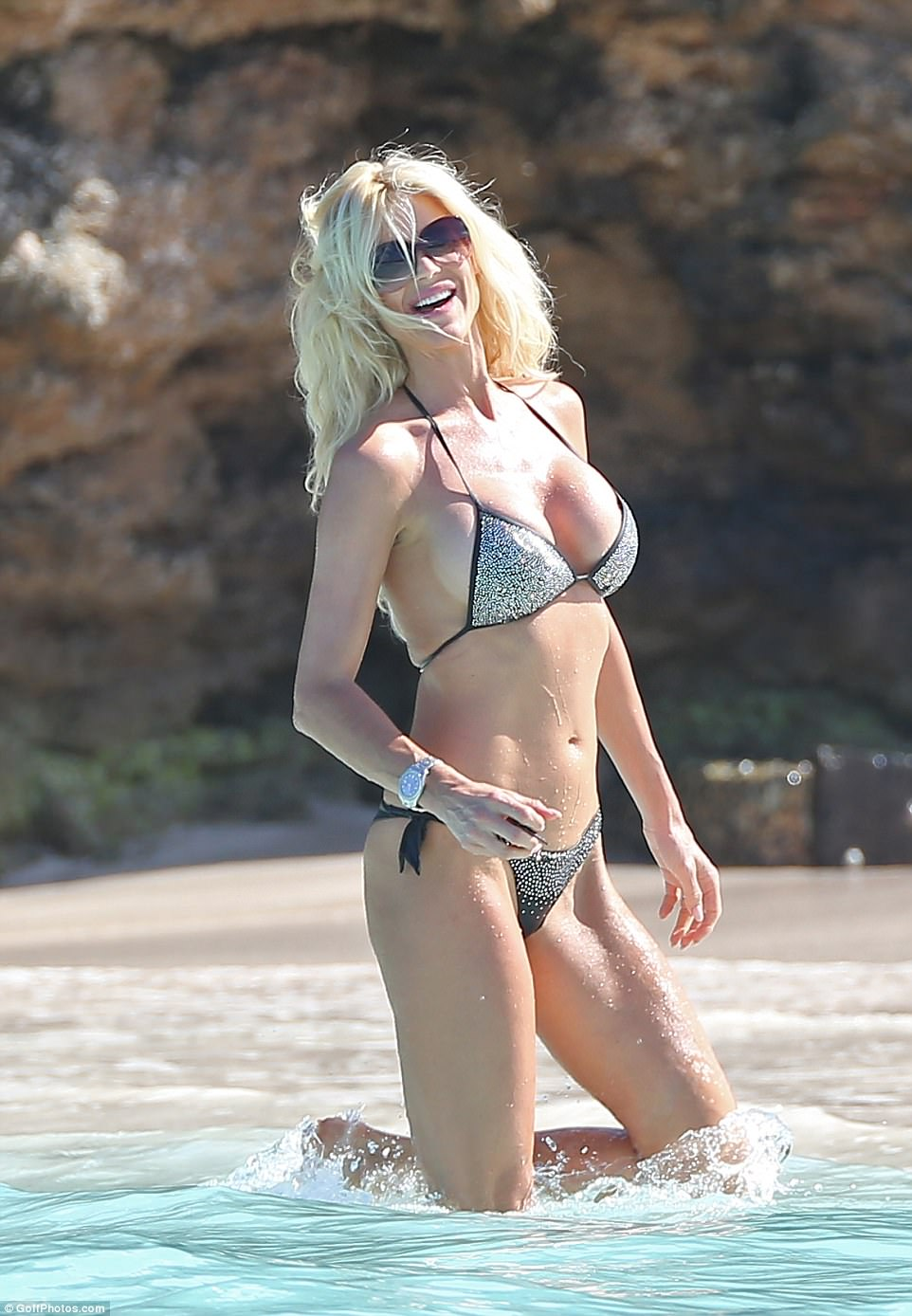 Beach babe: Victoria Silvstedt is a regular on the golden sands (here in December 2016)