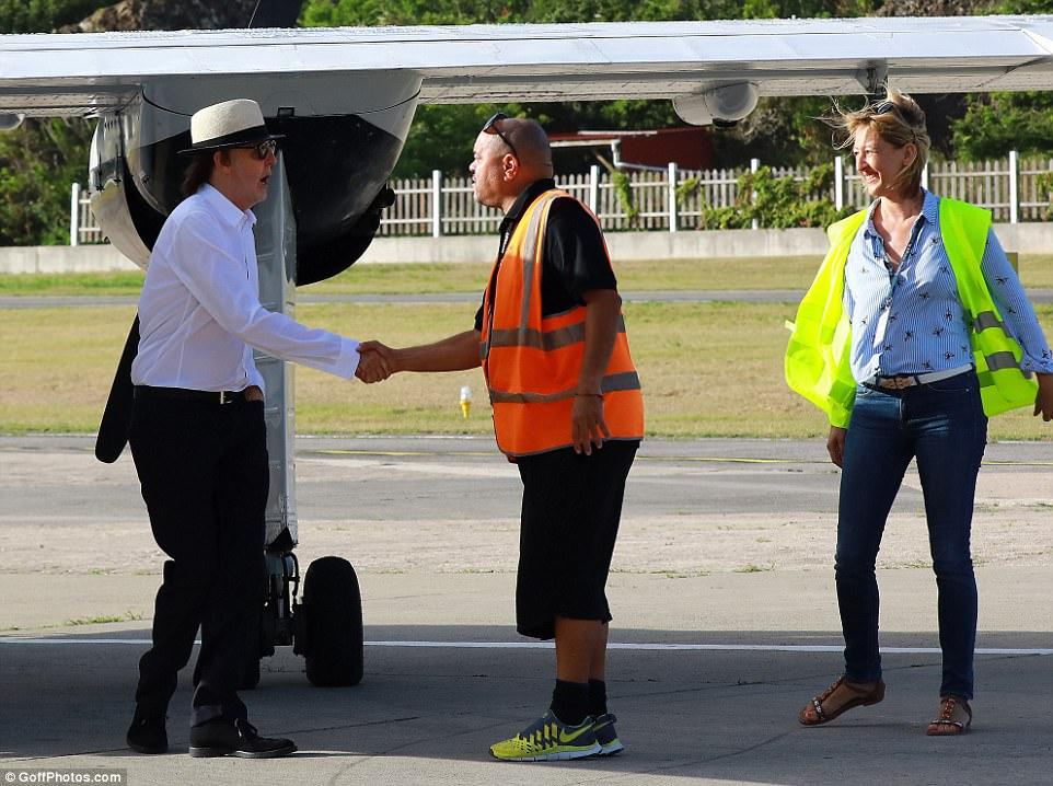 Man of the people: The Hey Jude singer beamed and shook hands with the airport crew when they touched down