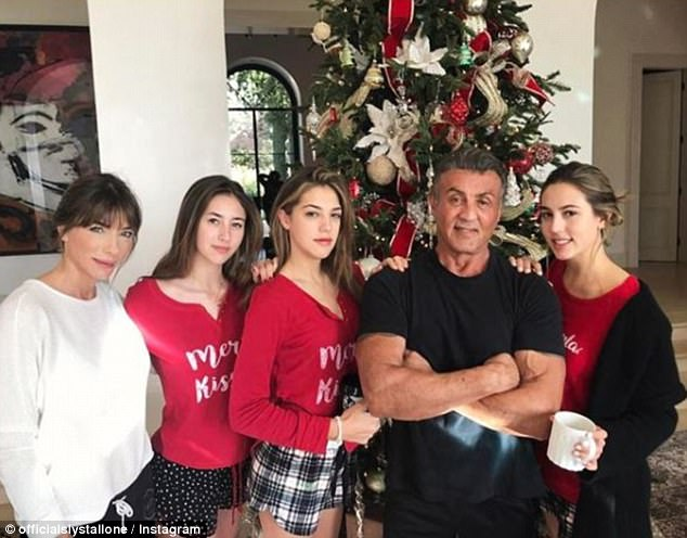 Happy day: Stallone posed with his (L-R) wife Jennifer Flavin and daughters Scarlet, Sistine and Sophia