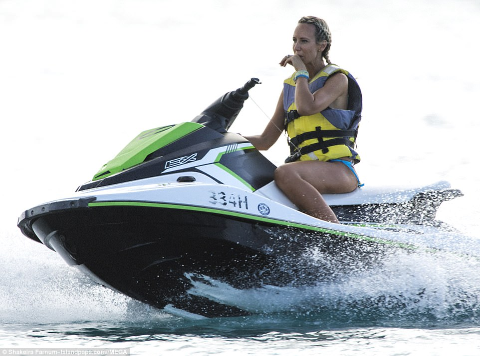 Svelte: Clad in a turquoise bikini, Victoria looked effortlessly cool during the adrenaline-fueled ride