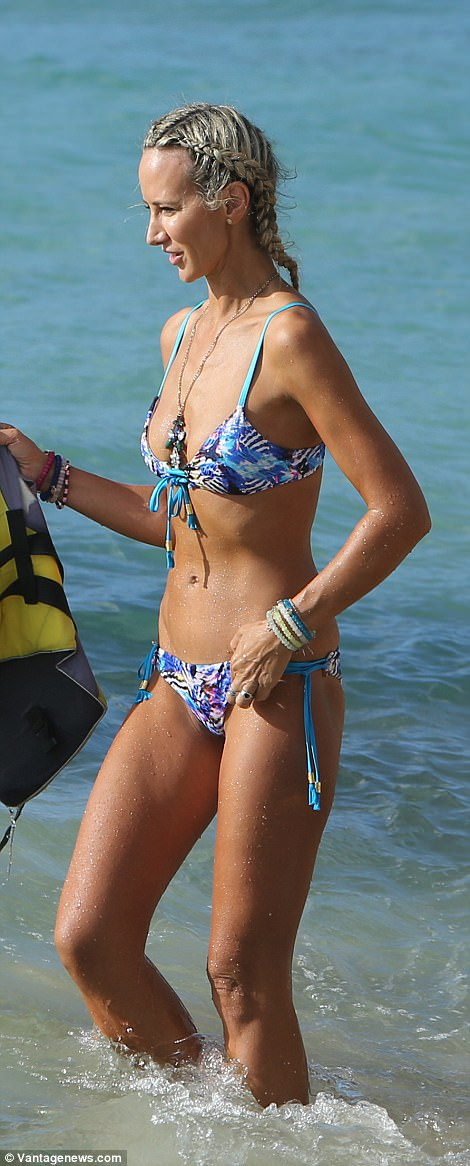 Trim: The 41-year-old proudly paraded her model figure as she took a jet ski for a spin in the water