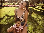 Chrissy Teigen found her 1-year-old daughter Luna (pictured with her) dragged into the bizarre Pizzagate conspiracy alleging the existence of a child sex ring