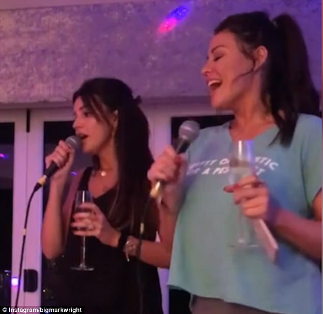 Doing Christmas (W)right: Michelle joined forces with sister-in-law Jess Wright for a powerhouse karaoke rendition of Tina Turner's Proud Mary