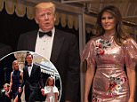 President Donald Trump speaks with reporters as he arrives for a New Year's Eve gala at his Mar-a-Lago resort with First Lady Melania Trump and their son Barron