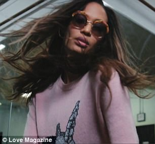 Pretty in pink: She removed her oversized tinted sunglasses as she revealed her pink sweater