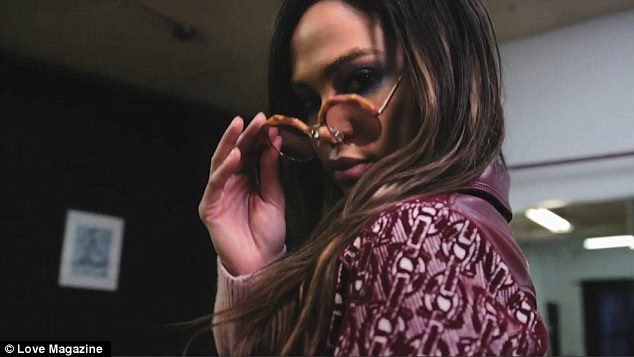Layered: At the start of the video, she was seen arriving in the studio wearing a mauve jacket