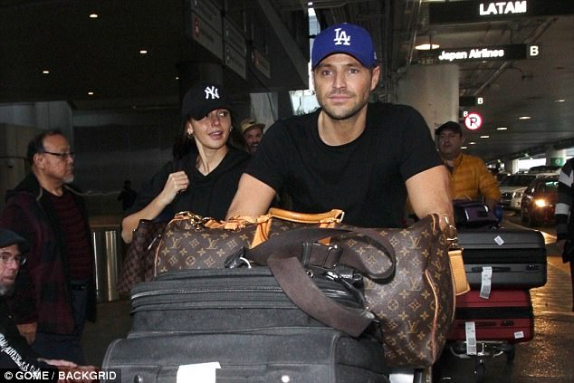 Glowing: Michelle Keegan proved she simply cannot get enough of husband Mark Wright over the festive period when they touched down in LAX airport on Wednesday as she made a rare visit to his temporary home
