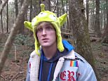 YouTube star Logan Paul (pictured during the video) has been forced to apologize after he was slammed for posting a sick video from Japan's 'suicide forest' that appeared to show a person who had hanged himself from a tree