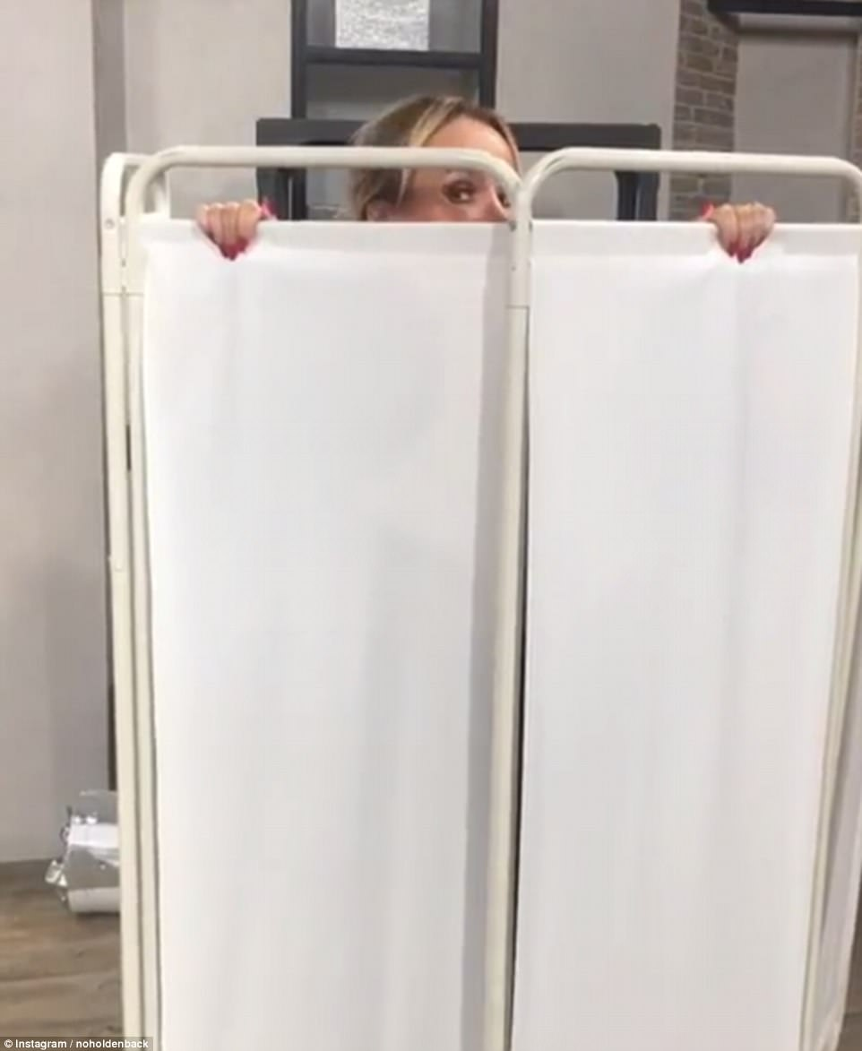 Playful!Poking fun at the inevitable Christmas weight gain Amanda hid behind a hospital style partition, while saying: 'On the seventeenth day of Christmas if like me you enjoy your food at Christmas and you don't want anyone to see you pack on the pounds invest in one of these