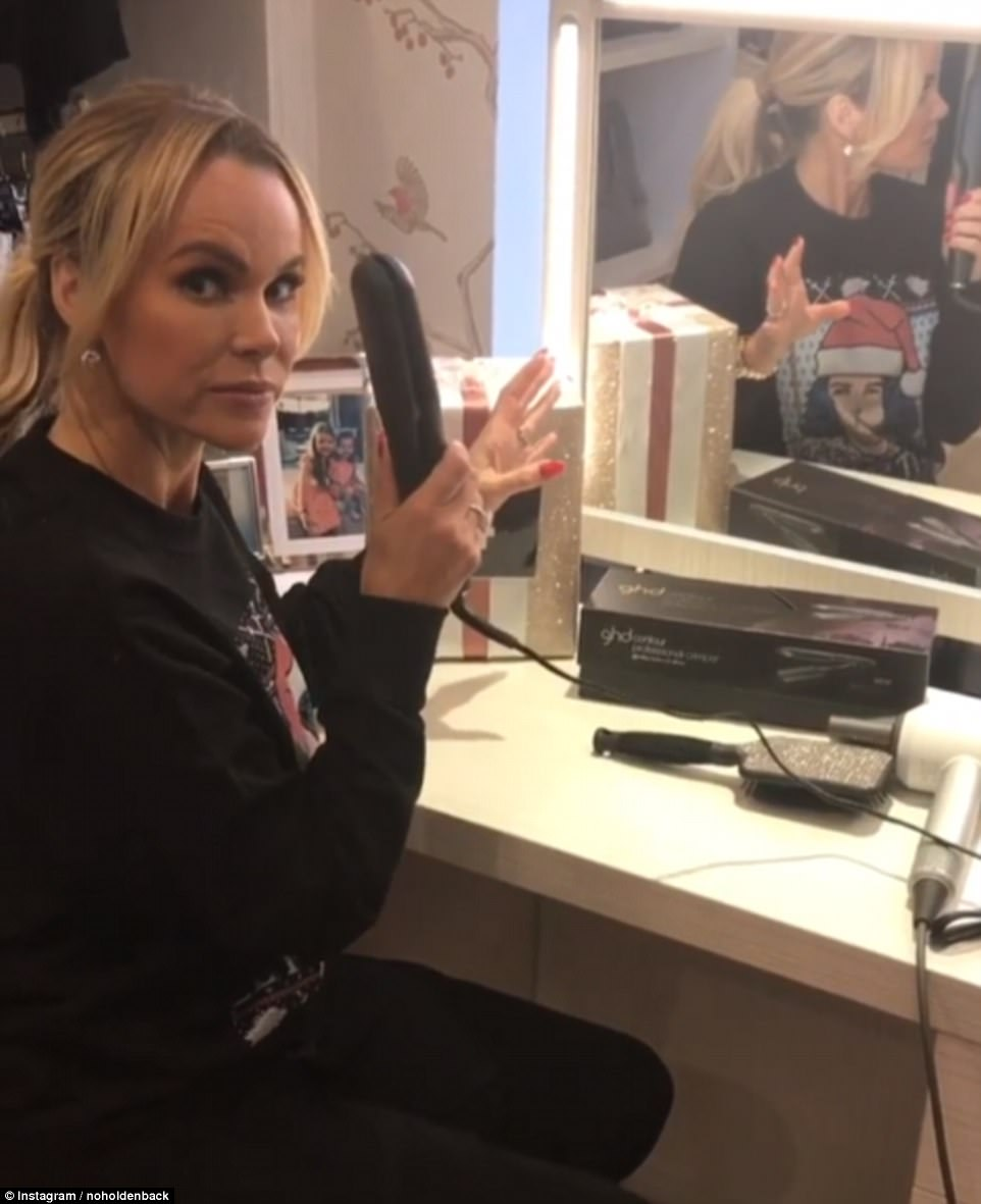 Merry Crimpmas:Back to 'endorsing', Amanda this time sat in what appeared to be the This Morning dressing room where she sat with a pair of £95 GHD crimpers - which she confessed would give an Eighties vibe