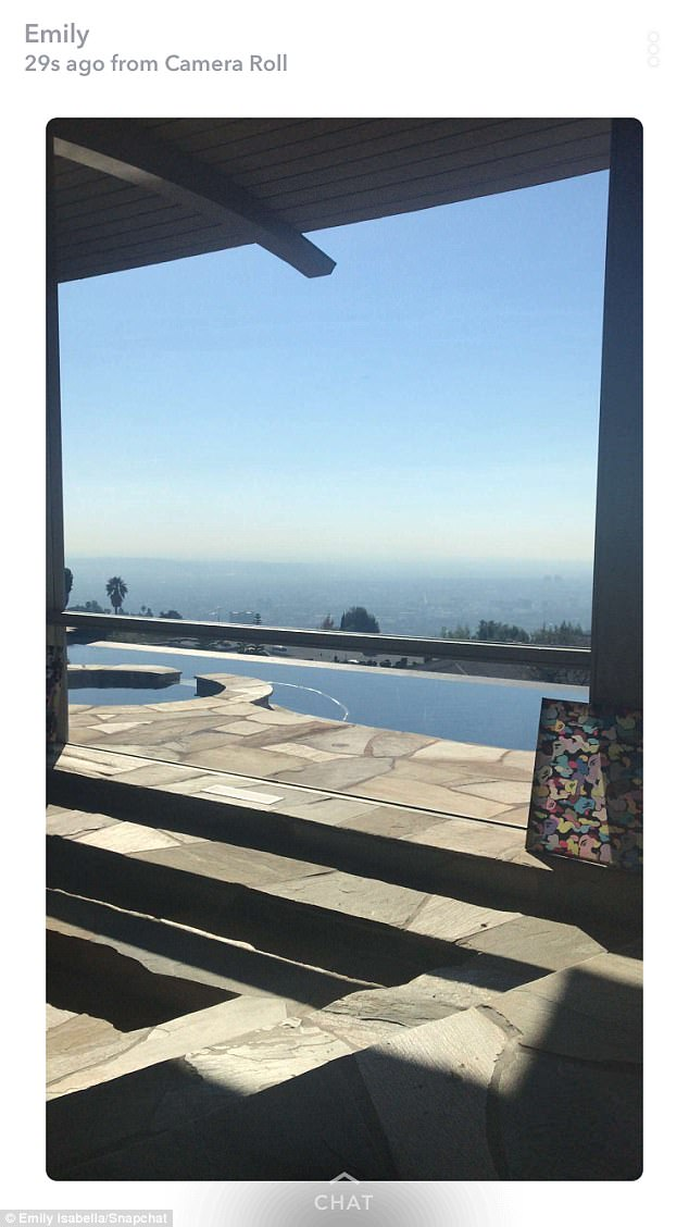 More of this: Another look at the stunning home with a large pool and a view of the skyline