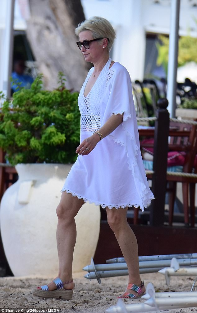 Stylish: Emma finished her look with strappy platform shoes as she strolled along the sands
