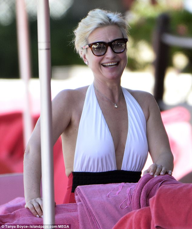 Beach babe: Emma was positively glowing when she spent time out of the sun