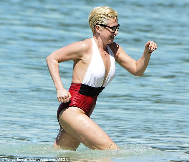 Making a splash: The TV personality has been topping up her tan on her recent beach trip