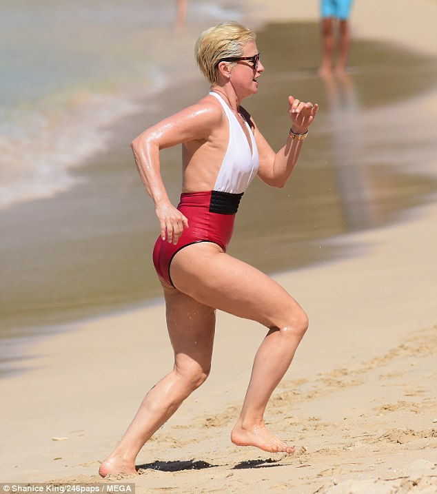 Beach babe: TV presenter Emma Forbes, 52, showed off her ageless beauty in a slinky swimsuit as she ran along the beach while holidaying in Barbados