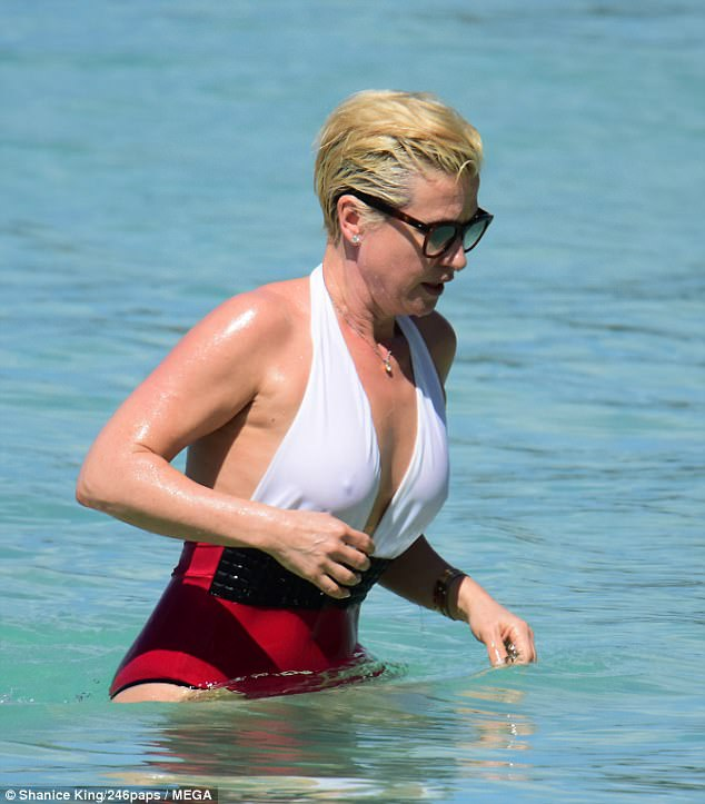 Stunning: Emma looked far younger than her years as she messed about in the waves