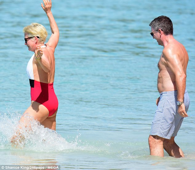 Joking around: Emma was joined on the getaway by husband of 30 years Graham, who kept it casual in blue printed swim shorts