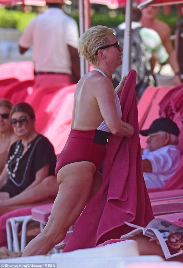 Cooled off: As Emma headed back to her sunbed, she grabbed a towel to dry off