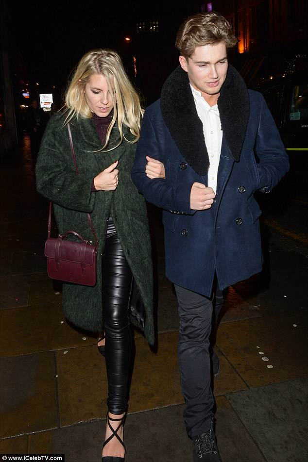 Lithe: Mollie showed off her toned figure in wet-look leggings  as she walked along arm-in-arm with AJ