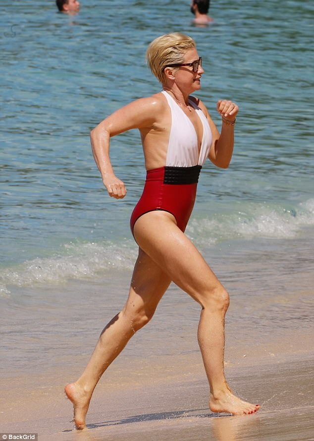Beach babe: The stunner looked lean as she kept up an exercise regime on the beach