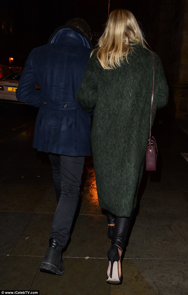 Tottering: Mollie showed off her vertiginous heels as she held onto her former dance partner's arm