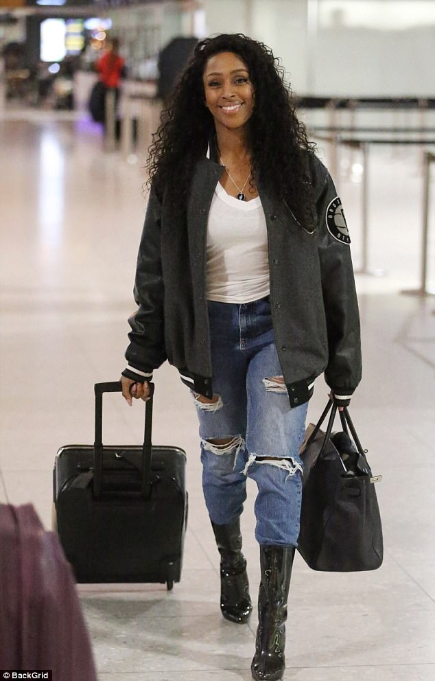 Some-ring to hide?Alexandra Burke, 29, fuelled rumours that she's engaged to beau Josh Ginnelly as she continued to hide her wedding finger at Heathrow airport on Boxing Day