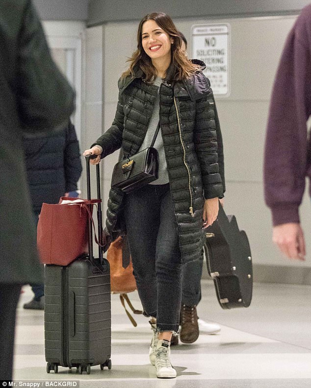 Happy gal:Mandy Moore, 33, was spotted smiling at JFK airport on Wednesday