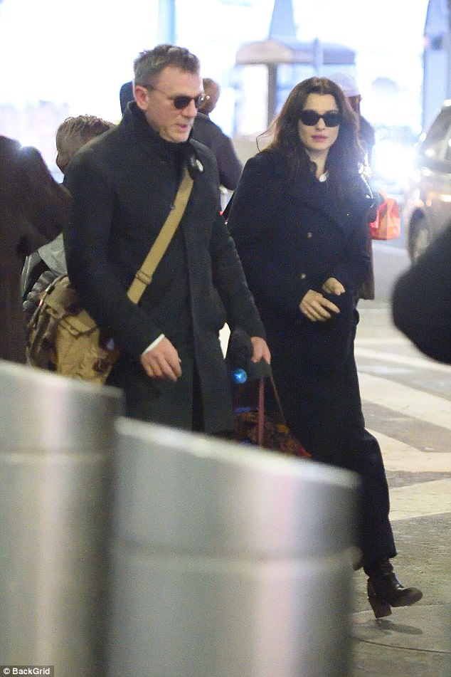 Loved up: Daniel Craig, 49,  and Rachel Weisz, 47, arrived at JFK Airport on Tuesday