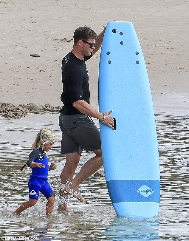 Surfing in style: Despite being a Byron Bay local, Chris still looked Hollywood cool, sporting a stylish pair of sunglasses in the water