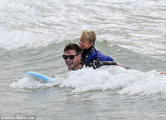 Surf's up! Chris and his youngster appeared overjoyed as they rode the waves together
