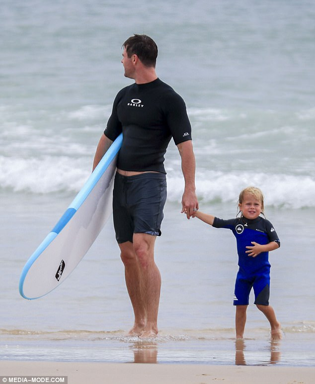 Wave runners: It appears the tot grow up sharing his father's affinity for the surfboard