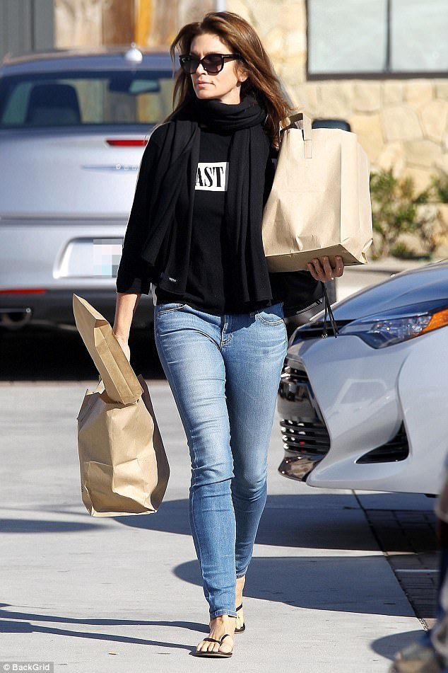 Stunner: Cindy Crawford, 51, stunned in a casual chic ensemble while grocery shopping in Malibu on Wednesday