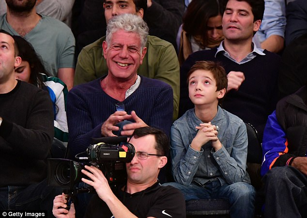 Action-packed: Celebrity chefAnthony Bourdain looked elated as he took in all of the action