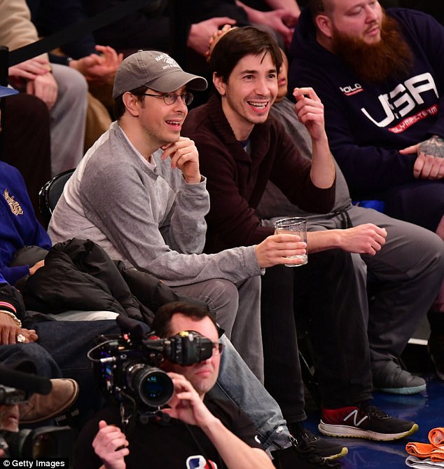 Smiles: Justin Long flashed a broad smile as he watched the Knicks romp home to victory