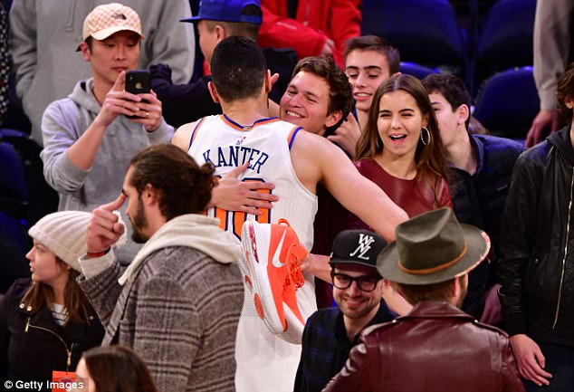 Hug: The Baby Driver star shared a hug with Knicks centre Enes Kanter as his girlfriend grinned