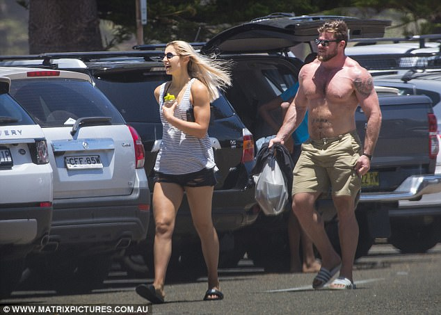 The Olympic rower was also seen carrying a number of Tupperware containers in a plastic bag as he approached the beach