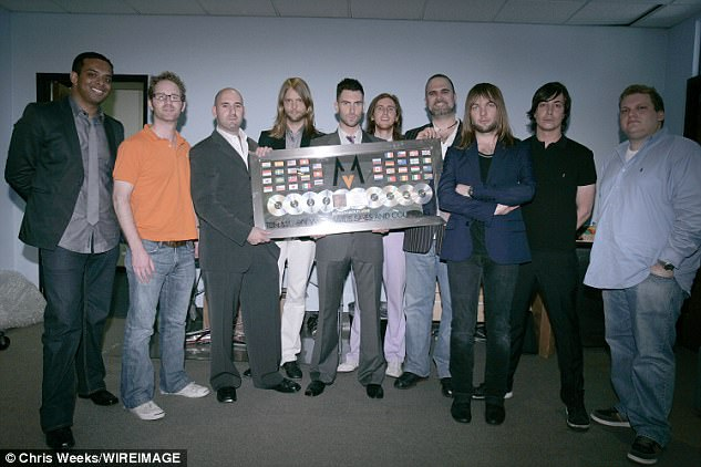 Sad news: The longtime manager of Maroon 5 Feldstein pictured (R) with the band back in 2007