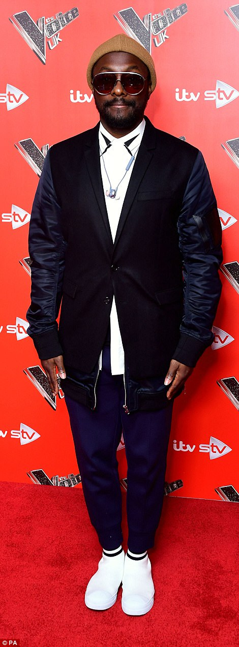 Dapper dudes: will.i.am showcased his quirky sense of style in a navy bomber jacket that he teamed with tapered trousers, gleaming white trainers and a beanie hat