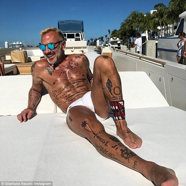 Topping up the tan:Italian businessman Gianluca Vacchi showed off his impressive physique on Tuesday as he spent Christmas aboard his yacht in Miami Beach