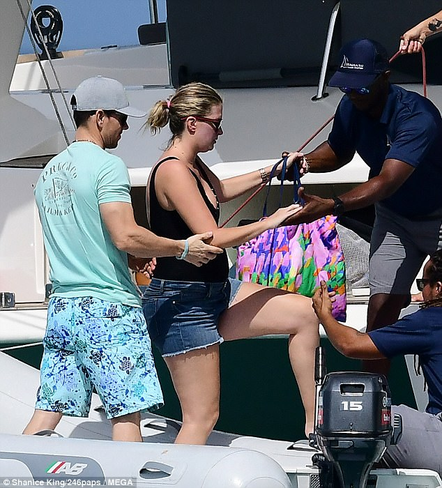 Yacht a man! Chivalrous Mark Wahlberg, 46, lent a helping hand to his model wife Rhea Durham, 39, as she stepped onto the boat in tiny shorts during Barbados break on Wednesday