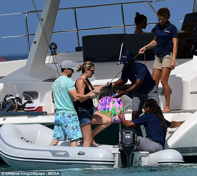 In the name of love: The Planet Of The Apes star proved himself to be the perfect gentleman when he helped Rhea onto the boat